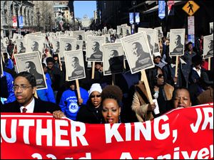 Participants march today down Fayetteville Street in Raleigh, N.C., during the 33rd annual Dr. Martin Luther King Jr. parade.