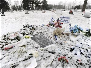 Snow covers the gravesite today of Joe Paterno in State College, Pa.
