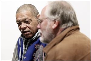 Mike Hampton, who has been out of prison for six years, left, speaks with volunteer Tom McCarter, right, during a monthly meeting at Government Center for the Re-Entry Coalition of Northwest Ohio, a group that lets those just released from prison know what social services are available to them to keep them from re-offending.