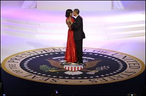 President Barack Obama and first lady Michelle Obama dance during the Commander-In-Chief Inaugural ball at the Washington Convention Center during the 57th Presidential Inauguration.