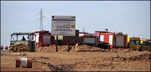 Rescue vehicles are parked at the natural gas plant near In Amenas, Algeria, where the hostage taking occurred. Algerian special forces made a final assault Saturday.