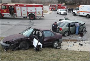 Toledo police and fire departments on the scene of a crash at Collingwood Blvd and Hamilton Street.