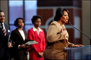 Bernice King, daughter ofMartin Luther King Jr., right, speaks during the annual Martin Luther King Jr. holiday commemorative service at the Ebenezer Baptist Church, in Atlanta.