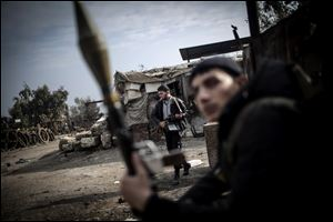 Free Syrian Army fighters hold their weapons during heavy clashes with government forces in Aleppo, Syria, Sunday.