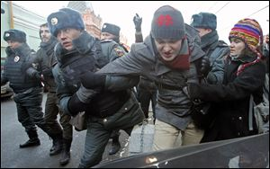Police officers detain gay right activists during a protest near the State Duma, Russia's lower house of parliament, in Moscow, Russia, in December.