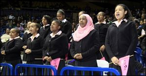 Students from Ella P. Stewart Academy recite their pledge during the Martin Luther King, Jr. Unity Celebration at the University of Toledo. The students, all sixth graders, are, from left: Jayona Wren, Taylor Hughes, Najae Pettaway, Imani Hicks, and Jayla Edwards.