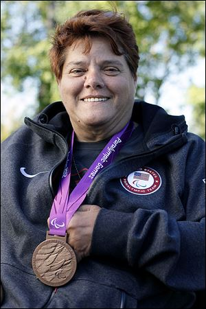 Zena Cole, of Oregon, poses at Pearson Metropark with her bronze medal which she won for the discus throw at the 2012 Paralympics in London.
