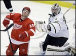 The Red Wings' Daniel Cleary, left, reacts after getting hit with the puck in front of Stars goalie Kari Lehtonen, who made 39 saves to help spoil Detroit's home opener Tuesday night.