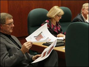 Sylvania city council member Michael Brown, left, takes a look at proposed blueprints for the new Fire Station No. 1 Tuesday evening during a presentation by Sylvania Township fire chief Jeff Kowalski. Though the fire station will double in its bed capacity for firefighters, it will remain in the same location on Monroe Street near the Sylvania downtown.