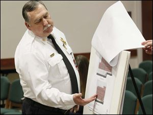 Sylvania Township fire chief Jeff Kowalski presents the proposed blueprints for a new Fire Station No. 1.