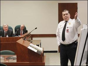 Sylvania Township fire chief Jeff Kowalski, right, presents the proposed blueprints for a new Fire Station No. 1.