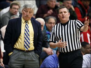 St. John's Jesuit head coach Ed Heintschel reacts to a call.