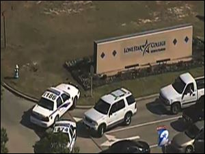 In this frame grab provided by KPRC Houston, police vehicles block an entrance to Lone Star College in Houston, where law enforcement officials say the community college is on lockdown amid reports of a shooter on campus.
