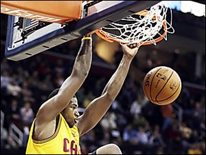 Tristan Thompson dunks for two of his 21 points against the Celtics. Kyrie Irving scored 40 points as Cleveland won.
