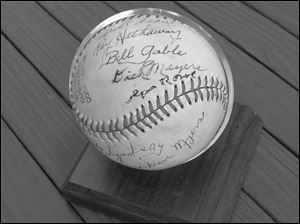 The signature of Dick Meyers is one up from the lower seam on this baseball, autographed by members of the 1948 Zanesville Dodgers.