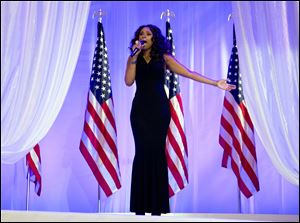 Jennifer Hudson sings as President Obama and first lady Michelle Obama dance together.