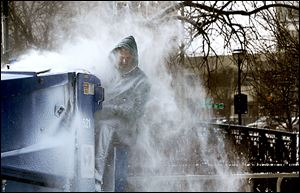 Kevin Miller drives the Zamboni at the Nibco Ice and Water Park in  Elkhart, Ind., on Tuesday, a day that made outdoor work a bigger challenge than normal.