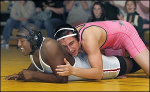 Clay's Eddie Silva, right, controls Central Catholic's Chris Norwood. Silva, a 195-pound senior, is 25-5 this season.