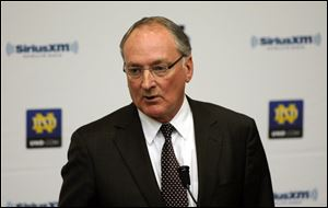 Notre Dame Athletic Director Jack Swarbrick speaks to reporters earlier this month during a news conference regarding a hoax involving linebacker Manti Te'o.