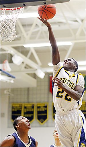 Whitmer's Jon Ashe grabs a rebound  against St. John's Jesuit's Anthony Glover. Ashe had eight rebounds in the contest at Whitmer.