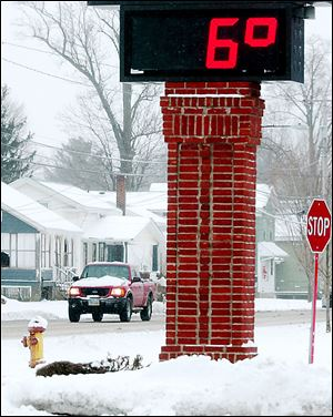 The thermometer on the Andover Bank in Austinburg Township east of Cleveland reflects the wave of arctic air that swept in from Canada Saturday night.