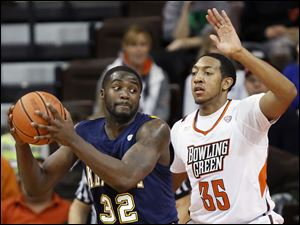 Bowling Green State University forward Cameron Black defends against Kent State forward Melvin Tabb.