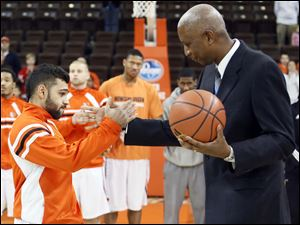 Prior to the game, Bowling Green State University head coach Louis Orr presents a ball to Jordon Crawford for passing the 1,000-career-points mark.
