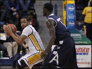 Dominique Buckley is guarded by Akron's Demetrius Treadwell during 2nd half at Savage Arena in Toledo.