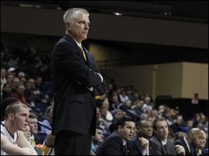 Toledo head coach Tod Kowalczyk watches as his team falls behind to Akron.