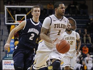 UT's Dominque Buckley is chased by Akron's Brian Walsh.