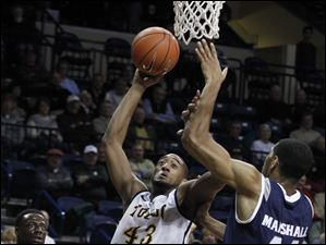 UT's Matt Smith shoots under pressure from Akron's Zeke Marshall.