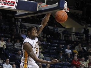 UT's Rian Pearson steals the ball and dunks it over Akron's Pat Forsythe.