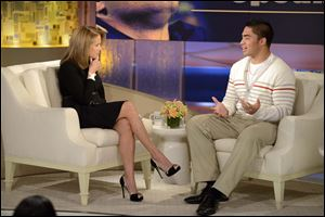 "Notre Dame linebacker Manti Te'o, right, speaks with host Katie Couric during an interview for ""Katie,"" in New York. The full interview is set to air Thursday."