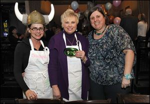 From left: Suzanne Rorick, executive director of the opera, Liz Ference and Susan Conda are celebrity waiters during Toledo Opera Guild's Celeb wait night at Fat Fish Blues and Comedy Club in Perrysburg, Ohio.