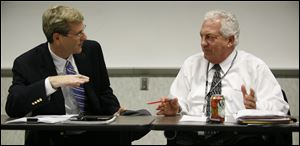 Board chairman Ron Rothenbuhler, right, and Republican board member Jon Stainbrook, left, said they learned about critical emails sent to the Secretary of State's office when they visited with officials in Columbus.
