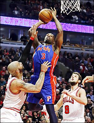Detroit's Rodney Stuckey shoots over Chicago's Carlos Boozer.