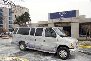 A shuttle van bears the vestiges of the former Hilton Toledo at the University of Toledo Medical Center. The campus lodging has been renamed The Hotel at UTMC after Hilton ended its affiliation.