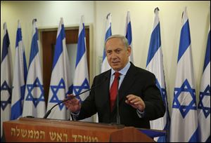 Israel's Prime Minister Benjamin Netanyahu delivers a statement at his office in Jerusalem today.