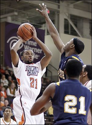 Bowling Green's Chauncey Orr shoots against Kent State's Chris Evans. The Falcons improved to 7-11 overall, 2-3 in the MAC.