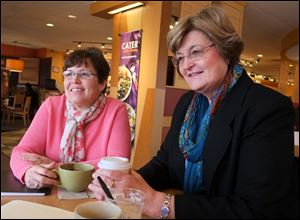 Sisters-in law Holly Stacy, left, and Doris Herringshaw talk at Panera Bread in Perrysburg. They will each serve as commissioners for the first time; Ms. Stacy in Seneca, Ms. Herrginshaw in Wood.