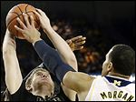 Jordan Morgan, right, blocks a shot by Purdue's Travis Carroll during  Michigan's win.