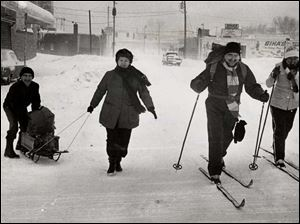 From left, Lloyd and Margaret Apling use a sled while Ray and Mary O'Donnell use skis to go grocery shopping on Tuesday, Feb. 7, 1978.