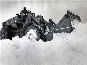 A front loader starts snow removal after the Blizzard of 1978.