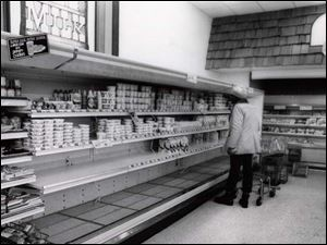 A customer looks over the milk counter at Joseph's at Franklin Park Mall in the days after the Blizzard of 1978.