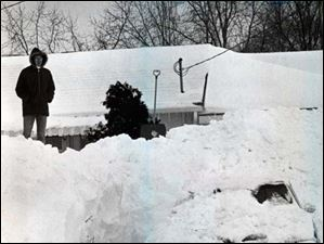 Dave Rickenberg of Liberty Center, Ohio, spent 4 hours digging out the  car in his driveway where the car was buried under a 10 ft snowdrift during the Blizzard of 1978.