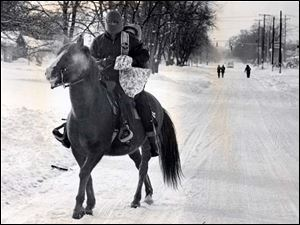 Andrew J. Webb and his son Andy Webb ride their horse Thunder on Jan. 27, 1978 after the blizzard.