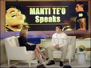 "Notre Dame linebacker Manti Te'o, right, speaking with host Katie Couric during an interview for ""Katie,"" in New York."