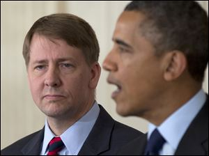 Richard Cordray stands left as President Obama announces that he will re-nominate Cordray to lead the Consumer Financial Protection Bureau, a role that he has held for the last year under a recess appointment.