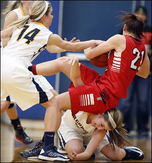 Archbold's Cassidy Williams, bottom, battles Wauseon's Alyssa Reed (21) for the ball during a game Thursday. Williams came off the bench to score a game-high 19 points for the Blue Streaks.
