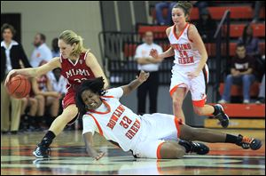 Miami's Hannah Robertson regains possession of the ball after Bowling Green's Alexis Rogers misses on a steal attempt.